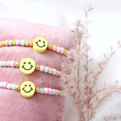 Kralen armband met smiley kraal
