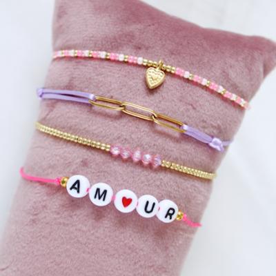 Roze/lila setje van 4 armbanden