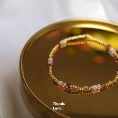 Gouden armbandje met paarse tussenkraaltjes