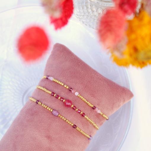 Setje van drie roze/paarse armbandjes